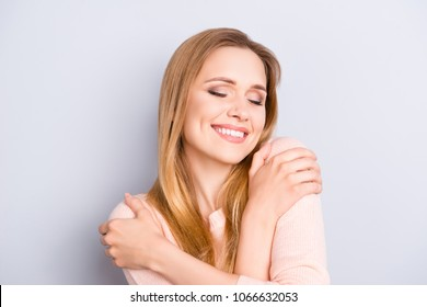 Yourself style stylish person optimist positive concept. Close up portrait of cute lovely charming adorable calm peaceful pleased girl hugging her shoulders isolated on gray background