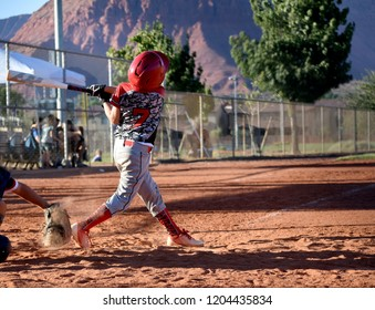 youth baseball batter swing and a miss