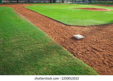 Youth baseball field viewed from first base side in morning light