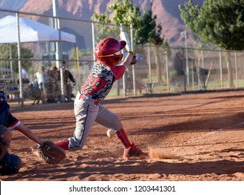 youth baseball player up to bat, strike, swing and miss