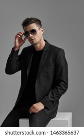 youth beauty man in suit dark clothes and glasses