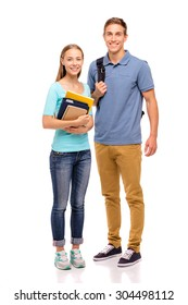 Youth and education. Young attractive students couple standing together. Full length studio portrait. Isolated on white.