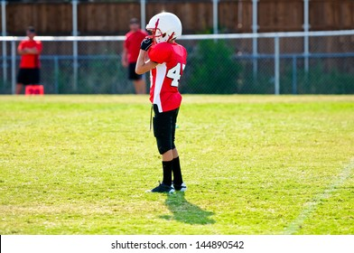 Youth football player on the field