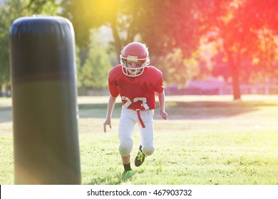 Youth football player practicing