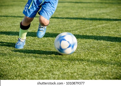 Youth Football Training on Sports Field. Young Boys Running and Kicking Soccer Ball.