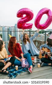 Youth lifestyle 20th birthday celebration on a roof top. Unconventional party. Happiness freedom and carefreeness