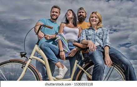 Youth likes cruiser bike. Cycling modernity and national culture. Company stylish young people spend leisure outdoors sky background. Group friends hang out with bicycle. Bicycle as best friend.