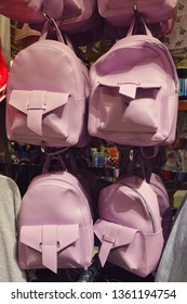 """Youth pink backpacks in the shopping center """"Primark"""" in the center of Madrid on Gran Via street."""