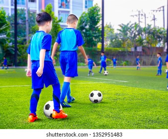 Youth soccer practice drills with cones. Soccer drills: slalom drill. Young football players training on pitch