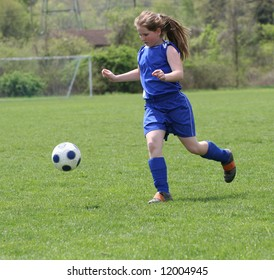Youth Teen Soccer Play on Field During Game.