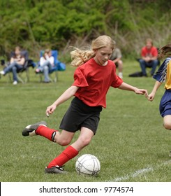 Youth Teen Soccer Player Kicking Ball on Field During Game 3