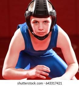 Youth wrestler in blue singlet.