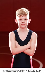 Youth wrestler with hands crossed