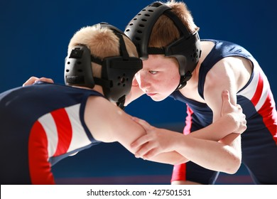 Youth wrestlers practice against each other.