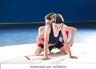 Youth wrestlers starting in the top and bottom positions