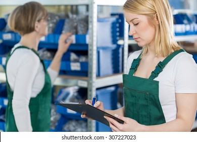 Youthful attractive girl is checking the product list