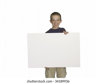 Youthful boy holding blank sign with room for copy text