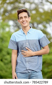 Youthful Colombian Teen Boy And Laughter