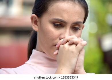 Youthful Filipina Woman Praying