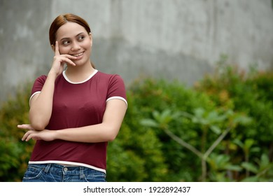 A Youthful Redhead Female Thinking