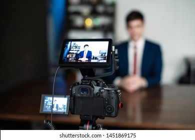YouTuber concept. Young caucasian man in video recording studio.
