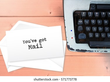 You've got mail on envelop letters stack with typewriter, vintage mail concept