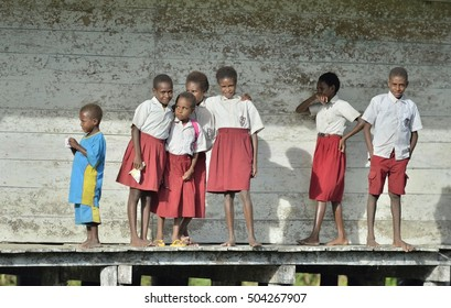 YOUW VILLAGE, ATSY DISTRICT, ASMAT REGION, IRIAN JAYA, NEW GUINEA, INDONESIA - MAY 23, 2016: Schoolchildren in uniform. Small village of the Asmat tribe.  New Guinea.May 23, 2016