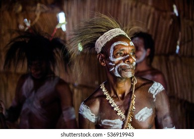 YOUW VILLAGE, ATSY DISTRICT, ASMAT REGION, IRIAN JAYA, NEW GUINEA, INDONESIA - MAY 23, 2016: Portrait of a man from the tribe of Asmat people. Asmat people village. New Guinea. May 23, 2016