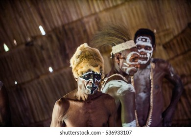 YOUW VILLAGE, ATSY DISTRICT, ASMAT REGION, IRIAN JAYA, NEW GUINEA, INDONESIA - MAY 23, 2016: Portrait of a man from the tribe of Asmat people. Asmat people village. New Guinea. May 23, 2016