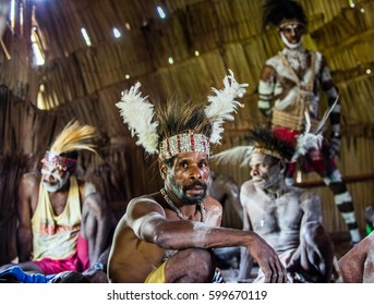 YOUW VILLAGE, ATSY DISTRICT, ASMAT REGION, IRIAN JAYA, NEW GUINEA, INDONESIA - MAY 23, 2016: Portrait of a man from the tribe of Asmat people with ritual face painting on Asmat Welcoming ceremony.