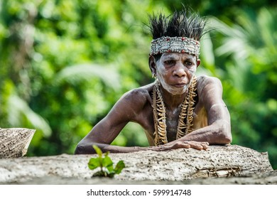 YOUW VILLAGE, ATSY DISTRICT, ASMAT, NEW GUINEA, INDONESIA - MAY 23: Portrait of Papuan woman from Asmat tribe in small village on the deep jungle of New Guinea. Irian Jaya. Indonesia. May 23, 2016