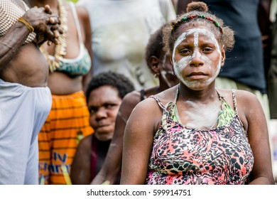 YOUW VILLAGE, ATSY DISTRICT, ASMAT, NEW GUINEA, INDONESIA - MAY 23: Portrait of Papuan women from Asmat tribe in small village on the deep jungle of New Guinea. Irian Jaya. Indonesia. May 23, 2016
