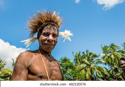 YOUW VILLAGE, ATSY DISTRICT, ASMAT REGION, IRIAN JAYA, NEW GUINEA, INDONESIA - MAY 23, 2016: Portrait of a man from the tribe of Asmat people with ritual headdress. Asmat Welcoming ceremony.