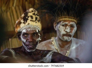 YOUW VILLAGE, ATSY DISTRICT, ASMAT REGION, IRIAN JAYA, NEW GUINEA, INDONESIA - MAY 23, 2016: Portrait of a man from the tribe of Asmat people on Asmat Welcoming ceremony. Inside men`s house.