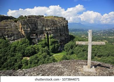 Ypapanti Monastery and memorial cross in Meteora region of Greece