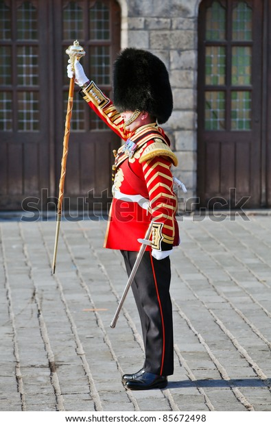 YPRES, BELGIUM - SEPT. 25:The Bandmaster of the Regimental Scots Guards band drops his staff of office to halt the marching bandsmen at the Ypres Military Tattoo on September 25,2011 in Ypres, Belgium