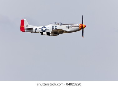 YPSILANTI - JULY 24 : A P-51 Mustang Gentleman Jim flies by at Thunder Over Michigan air show on July 24, 2011 in Ypsilanti, Michigan.