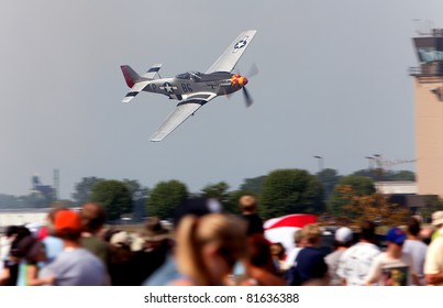 YPSILANTI, MI - JULY 24 : A P-51 Mustang flies above the crowd at the Thunder Over Michigan air show on July 24th, 2011 in Ypsilanti, Michigan.