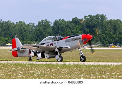 YPSILANTI, MI - JULY 24 : A P-51 Mustang on the runway at the Thunder Over Michigan air show on July 24, 2011 in Ypsilanti, Michigan.