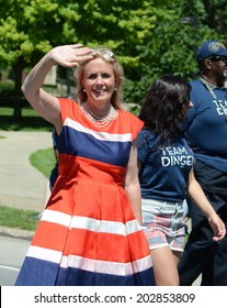YPSILANTI, MI - JULY 4: Debbie Dingell, Democratic candidate for Michigan's 12th congressional district, waves at the 4th of July parade on July 4, 2014 in Ypsilanti, MI.