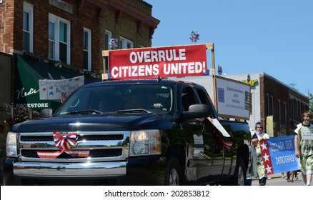 YPSILANTI, MI - JULY 4: Marchers opposed to the Citizens United decision march at the 4th of July parade on July 4, 2014 in Ypsilanti, MI.