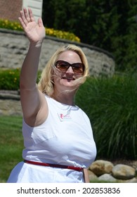 YPSILANTI, MI - JULY 4: Michigan State Senator Rebekah Warren waves at the 4th of July parade on July 4, 2014 in Ypsilanti, MI.