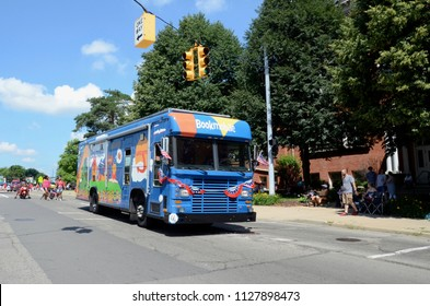 YPSILANTI, MI / USA - JULY 4, 2018:  The Ypsilanti district library's Bookmobile participates in the Ypsilanti fourth of July parade.