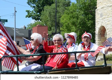 YPSILANTI, MI / USA - JULY 4, 2018:  Original Rosie the Riveters participate in the Ypsilanti Fourth of July parade in support of saving the Willow Run bomber plant.