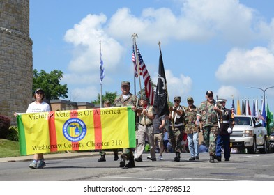 YPSILANTI, MI / USA - JULY 4, 2018:  Representatives of the Vietnam Veterans of America Washtenaw County Chapter march in the Ypsilanti Fourth of July parade.