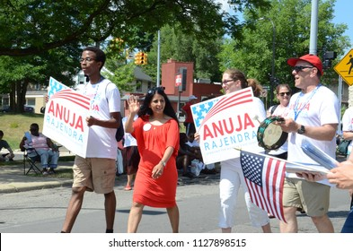 YPSILANTI, MI / USA - JULY 4, 2018:  Anuja Rajendran, democratic candidate for Michigan State Senate, marches in the Ypsilanti Fourth of July parade .