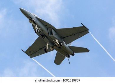 YPSILANTI, MICHIGAN / USA - August 20, 2016: A United States Navy F/A-18 Super Hornet performs a demo at the 2016 Thunder Over Michigan Airshow at Willow Run airport.