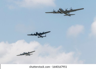 YPSILANTI, MICHIGAN / USA - August 29, 2015: A very rare formation of World War II era aircraft - a B-29 Superfortress, B-17 Flying Fortress, and Avro Lancaster