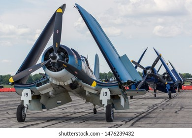 YPSILANTI, MICHIGAN / USA - August 3, 2019: A large group of F4U Corsairs prepare for a performance at the 2019 Thunder Over Michigan Airshow.