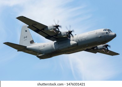 YPSILANTI, MICHIGAN / USA - August 3, 2019: A Royal Canadian Air Force CC-130 Hercules performs at the 2019 Thunder Over Michigan Airshow.